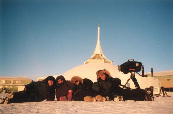 Crew shot taken in the light of the setting afternoon sun outside the local church which is shaped like an igloo.