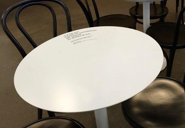 "All the tables in the cafe have different quotations from Quebecois authors. This one reads: ""S'il fait nuit, regarde les constellations, qui naissent, au-dedans de toi"", Gille Hénault, entre 1959-1963"